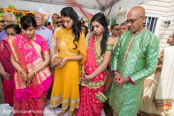Indian bride and Indian relatives saying a prayer