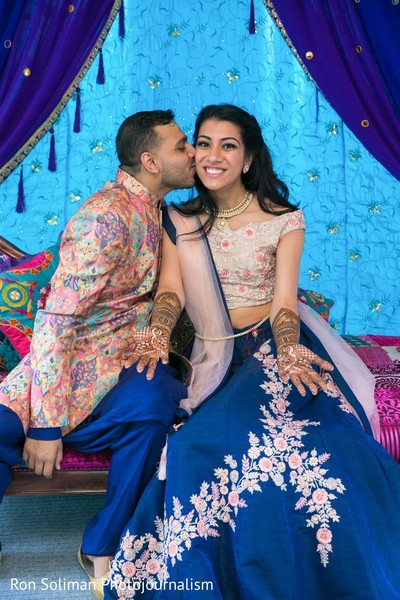 Indian groom kissing the Indian bride's cheek