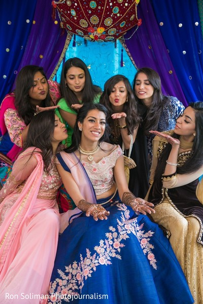 Indian bridesmaids blowing kissed to the Indian bride