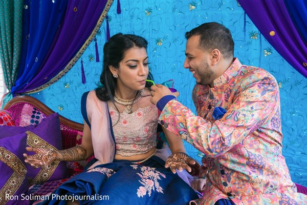 Indian groom giving a drink to his Maharani