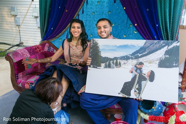 Indian groom showing a picture of him and Maharani