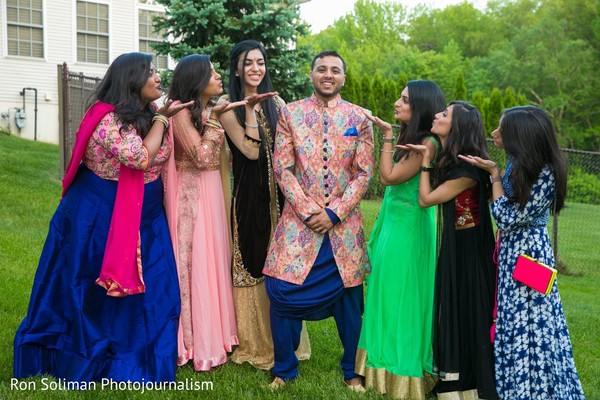 Indian bridesmaids blowing kissed to the Indian groom
