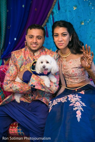 Indian couple posing with a pet dog