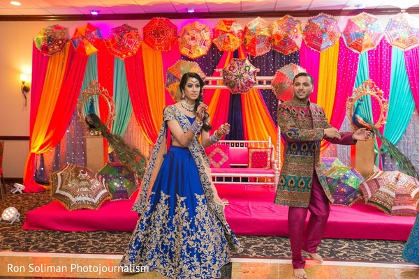 Indian couple dancing in front of the decorated stage