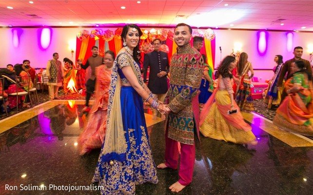 Indian couple holding hands on the dance-floor