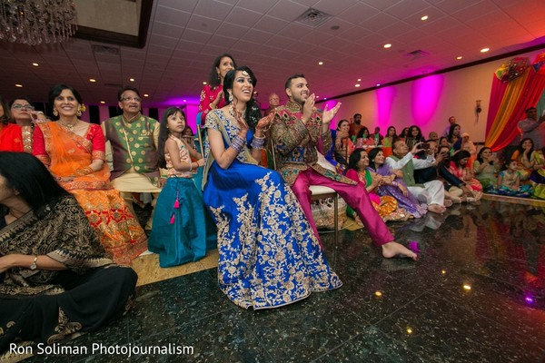 Indian couple and Indian relatives enjoying one of the performances