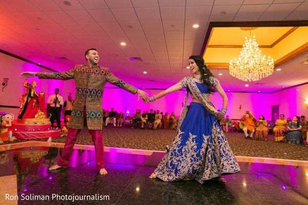 Indian couple dancing during Sangeet