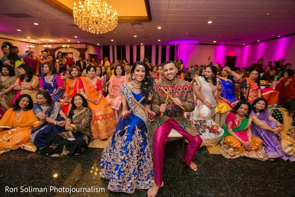 Indian couple posing with their Indian relatives and guests