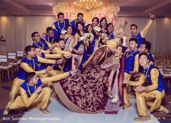 Indian groomsmen and bridesmaid cheering for the Indian couple