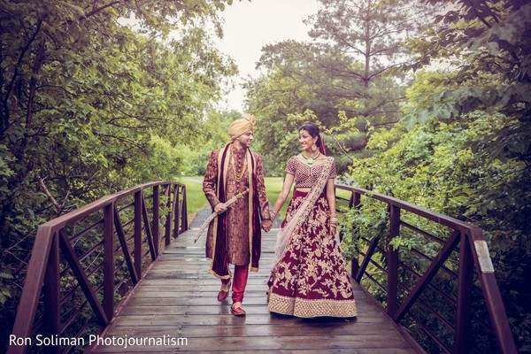 Indian couple crossing a bridge hand in hand