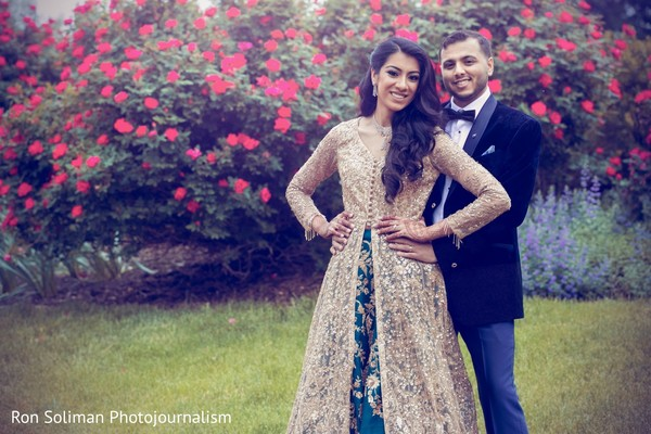 Indian couple posing together on a garden