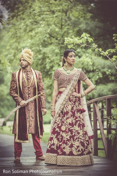 Indian couple posing on a bridge