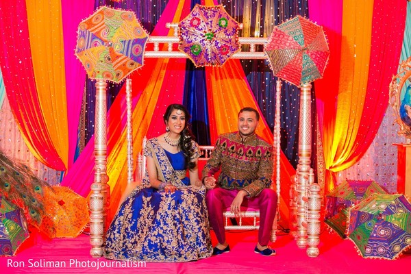 Indian couple sitting on a decorated stage