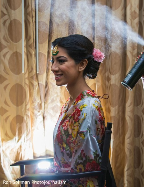 Indian bride getting her wedding ceremony hair style.