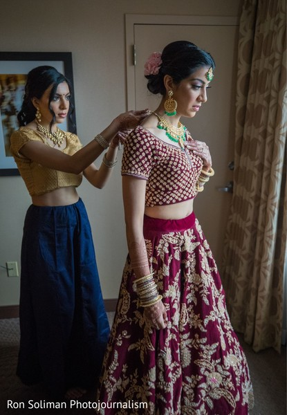Indian bride getting her kundan choker necklace.