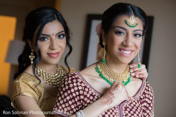 Indian bride getting her wedding ceremony kundan choker necklace.