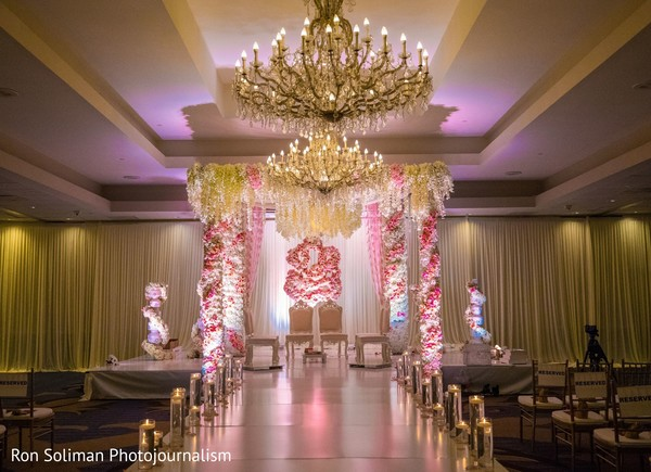 Pink and white indian wedding mandap flowers decorations.
