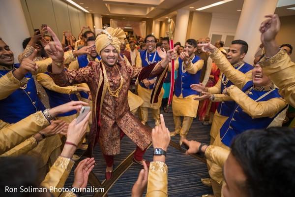 Indian groom dancing at baraat.