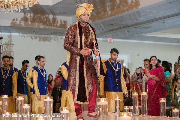 Indian groom walking down the aisle.