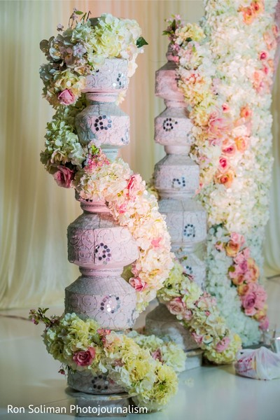 Indian wedding white pot pillars decorations with real flowers.