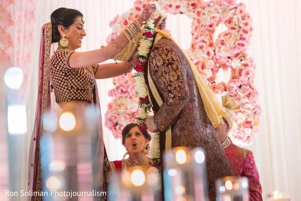 Maharani putting garland to groom ritual.