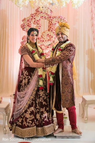 Indian couple at the jaimala ritula capture.