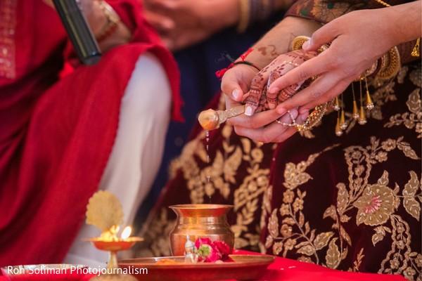Maharani and raja pouring oil to sacred fire.