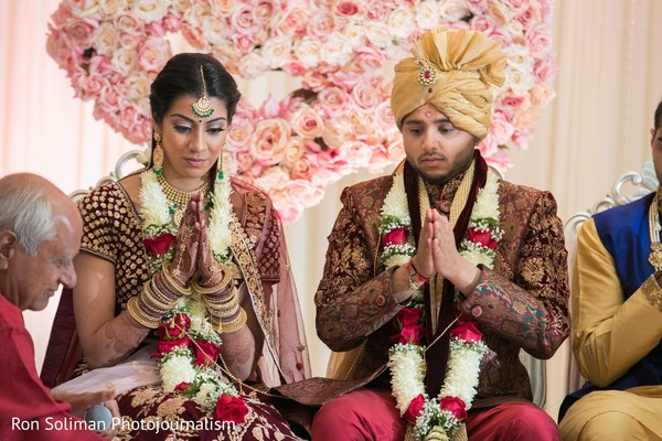 Indian bride and groom at their ceremony ritual capture.