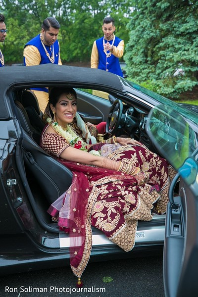 Indian bride getting on her wedding vehicle.