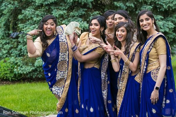 Indian bridesmaids on their golden and royal blue saree.