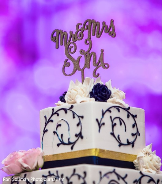 Indian wedding personalized golden cake topper.