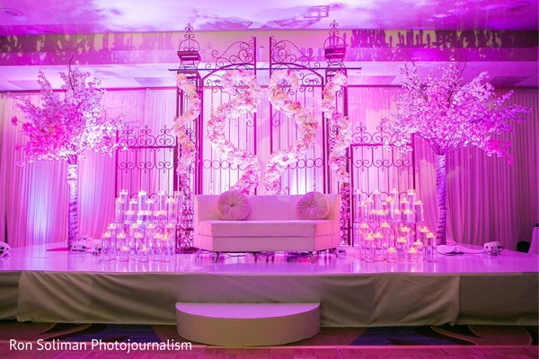 Pink indian wedding reception stage lights decoration.