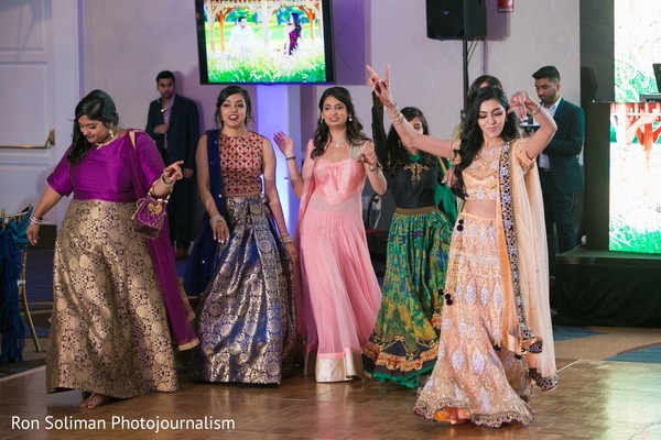 Indian bridesmaids making their entrance to wedding reception.
