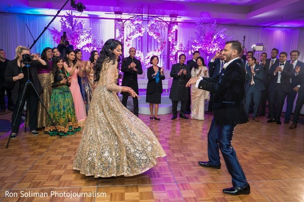 Indian bride and groom at wedding reception first dance.