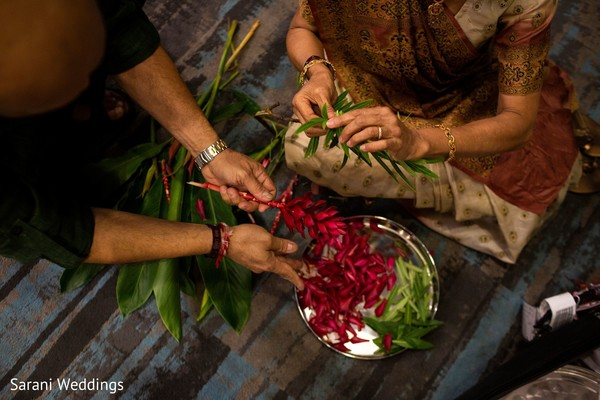 Getting the Indian wedding ritual petals ready for ceremony.