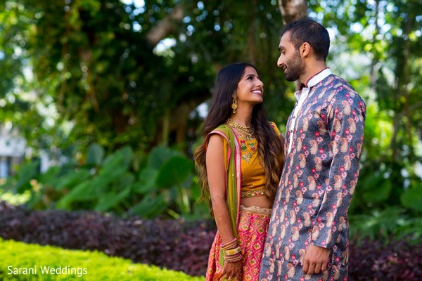 Indian bride and groom on their pre-wedding outfits.