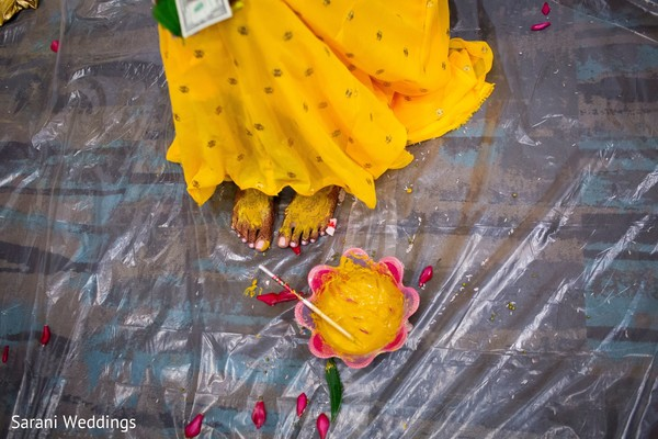 Maharani with her feet smeared with turmeric paste.