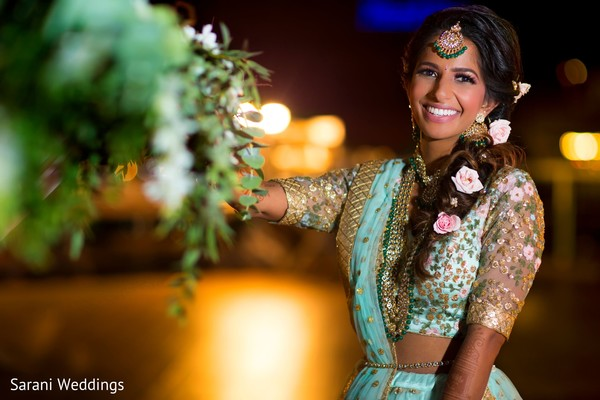 Indian bride on her sky blue and golden lehenga.