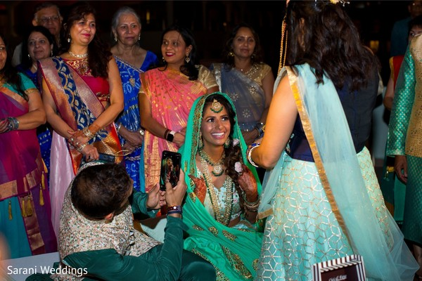 Indian bride with groom and relatives at sangeet party.