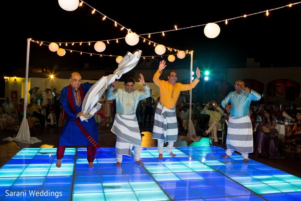 Indian relatives performing a sangeet dance.