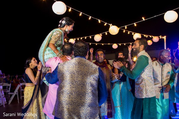 Indian bride lifted by groomsmen at sangeet.