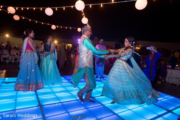 Sky blue Sangeet lights on dance floor.