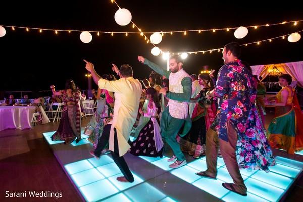 Indian Sangeet guests dance capture.