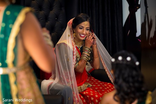 Maharani getting her earrings on .