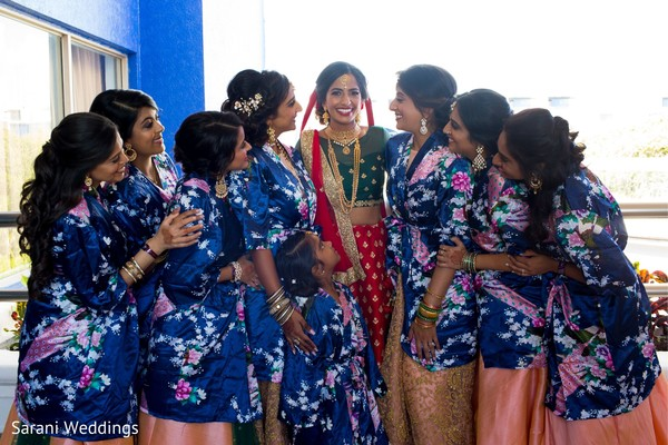 Indian bride with bridesmaids with flower girl photography.