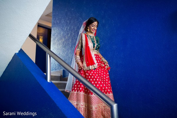 Red, golden and green Indian bridal ceremony lehenga.
