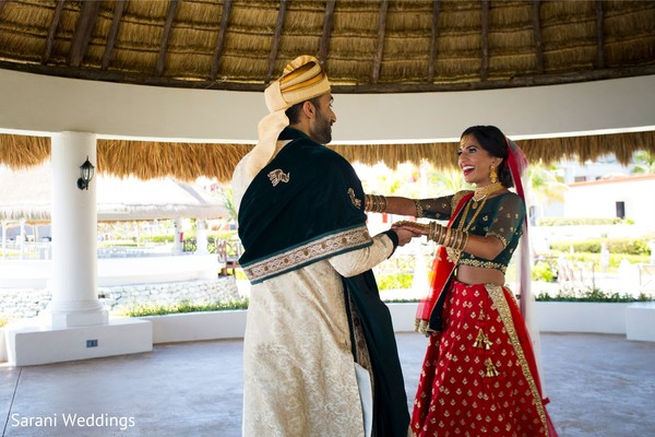 Indian bride and groom admiring each other capture.