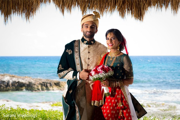 Indian bride and groom on their ceremony  outfits.