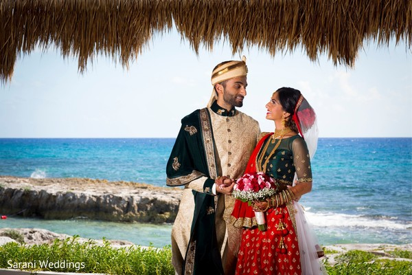 Indian couple next to sea shore photo session.