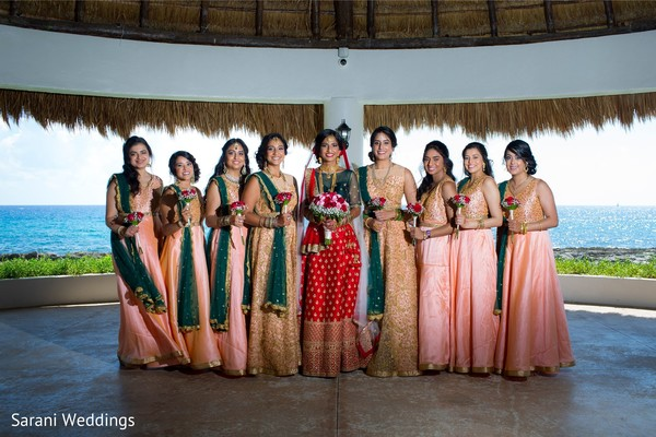 Indian bride with bridesmaids posing on ceremony outfits.